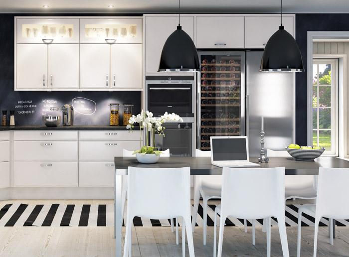 Rostfritt högskåp från mQuvée inbyggt i ljust kök